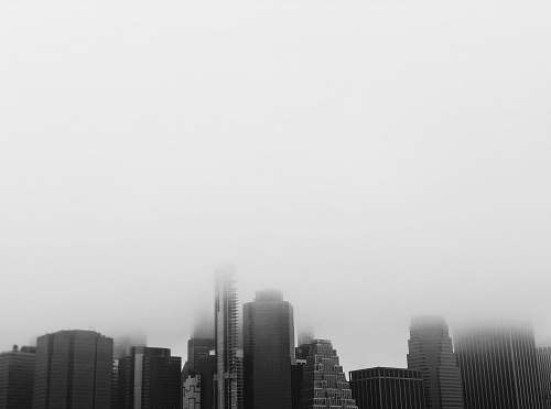 nature grayscale photography of buildings smoke