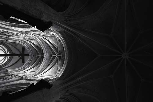 architecture grayscale photography of crucifix placed inside cathedral lyon