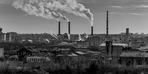 pollution grayscale photography of factory smoke