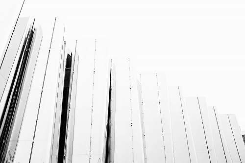 architecture grayscale photography of fence building