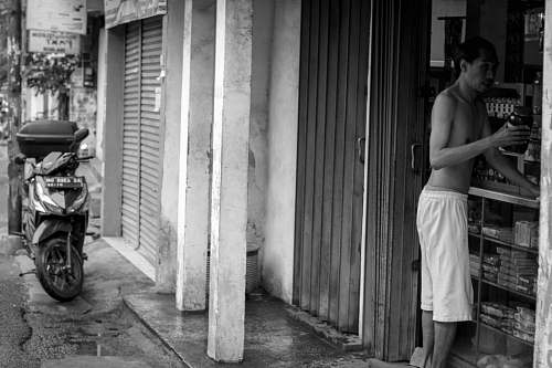 apparel grayscale photography of half naked man at store clothing