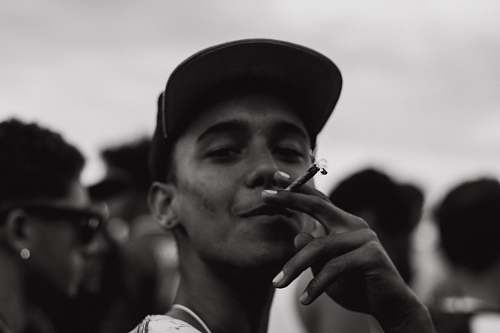 people grayscale photography of man smoking human