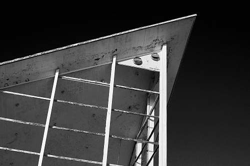 grey grayscale photography of metal arch roofg architecture