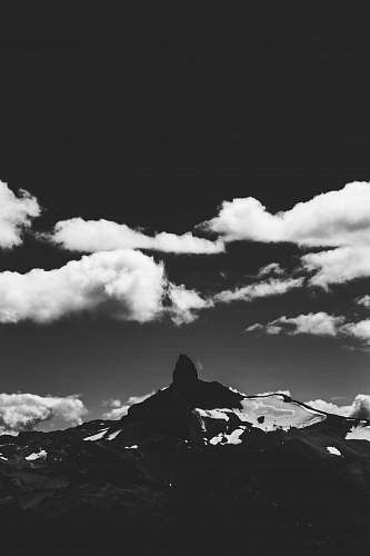 mountain grayscale photography of mountain and clouds nature