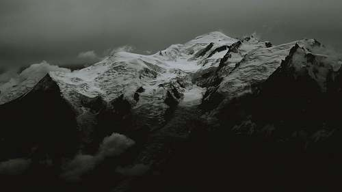 nature grayscale photography of mountain range mountain