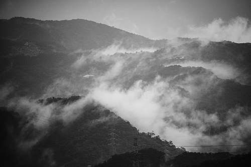 nature grayscale photography of mountain with clouds grey