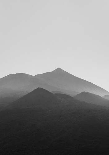 mountain grayscale photography of mountains mountain range
