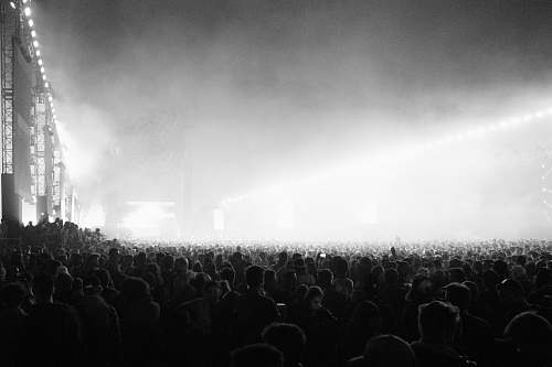 indoors grayscale photography of people in concert interior design