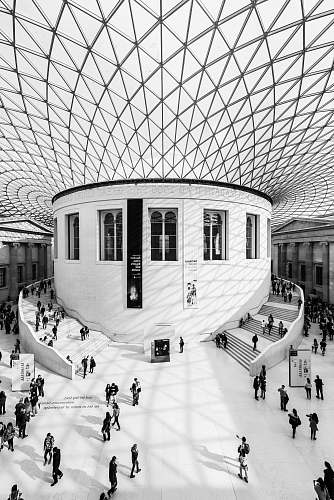 london grayscale photography of people inside building british museum