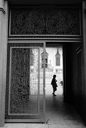 phnom penh grayscale photography of person standing near hallway cambodia