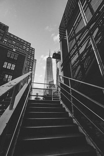 grey grayscale photography of stairway leading to building architecture