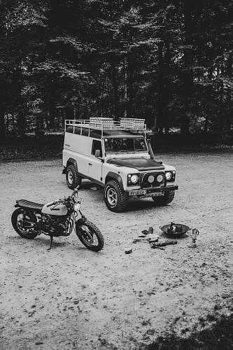 motorcycle grayscale photography of SUV and motorcycle transportation