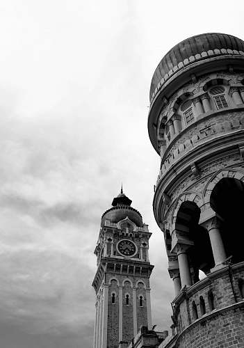 architecture grayscale photography of towers building