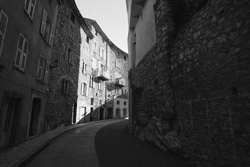 building grayscale photography of townhouse street