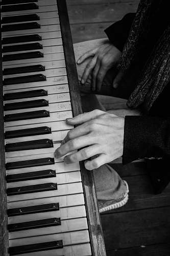 grey grayscale photography of upright piano electronics