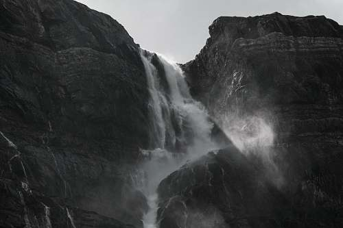 nature grayscale photography of waterfalls outdoors