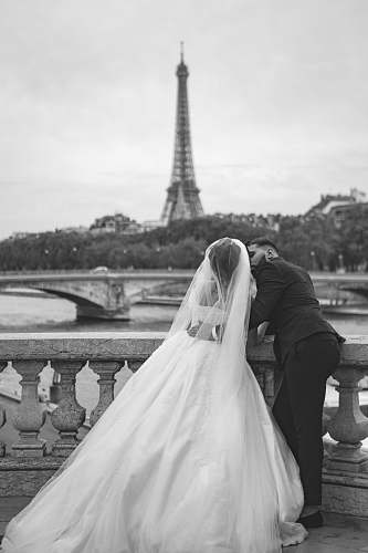 apparel grayscale photography of wedding couple in front of Eiffel Tower clothing