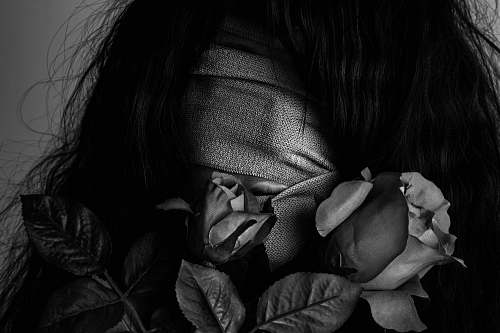 human grayscale photography of woman covered by strap skin