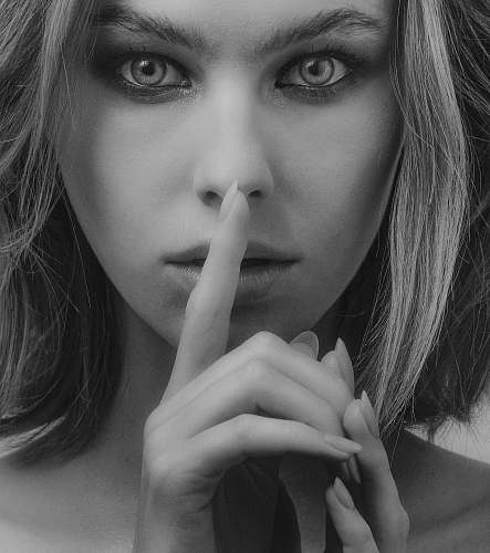 human grayscale photography of woman doing silent sign person
