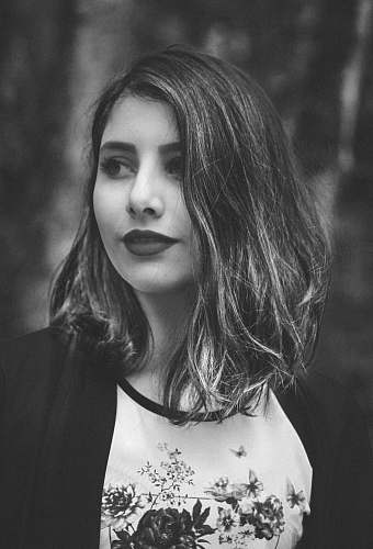 grey grayscale photography of woman wearing cardigan people