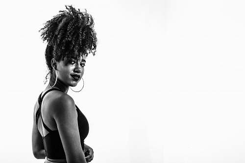 human grayscale photography of woman wearing sports bra person