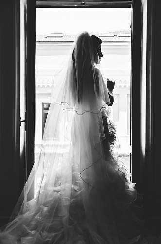 clothing grayscale photography of woman wearing wedding dress apparel