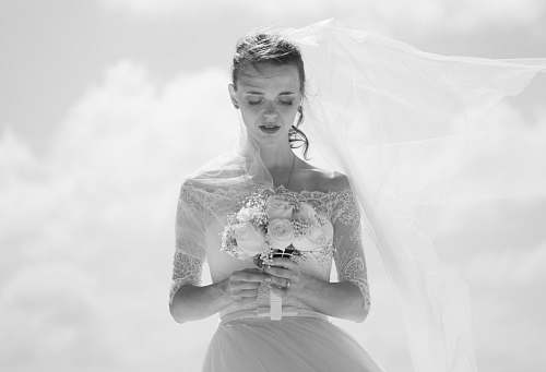 grey grayscale picture of bride holding flower bouquet wedding