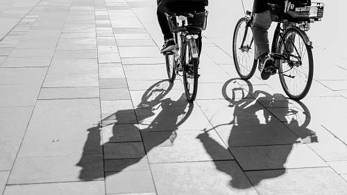photo bicycle grayscape photo of person riding bike bike free for commercial use images