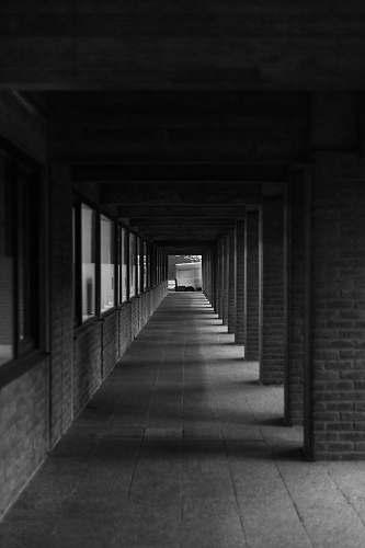 grey grey scale photography of pathway corridor