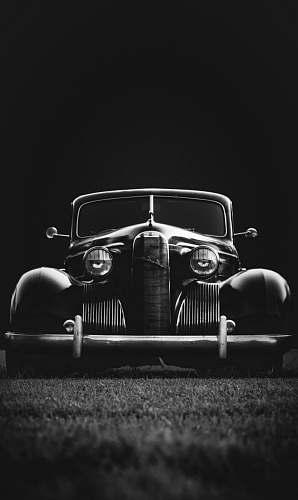 car greyscale photo of classic vehicle on ground vehicle
