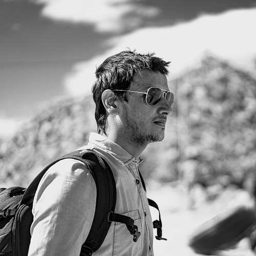 human greyscale photo of man wearing sunglasses person