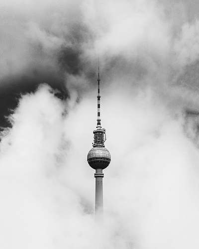 architecture greyscale photo of tower covered in smoke berlin