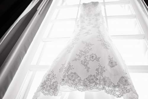 clothing hanged white and gray wedding dress apparel