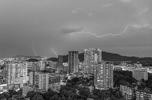 nature lightning strikes over the city weather