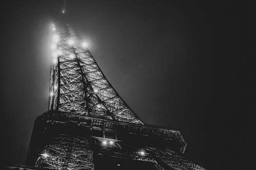 architecture low angle photography of Eiffel Tower lighting