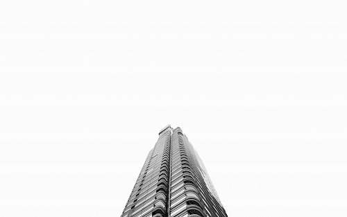 building low-angle photography of grey high-rise building architecture