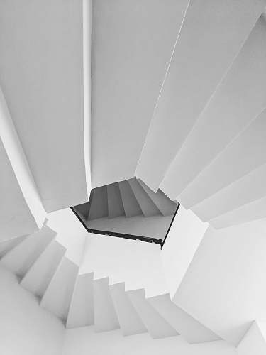 banister low angle view of white spiral stairs handrail