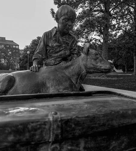 human man holding animal statue person