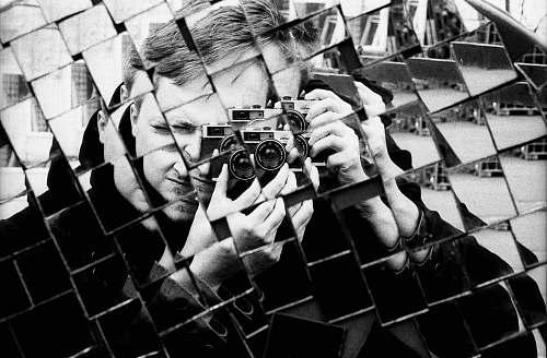 reflection man holding DSLR camera mirror