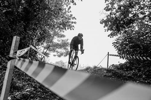 bicycle man riding bike during day bike