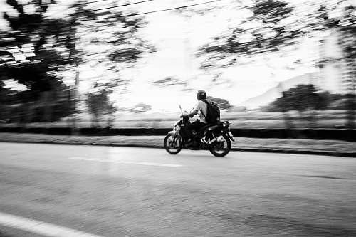 motorcycle man riding motorcycle transportation