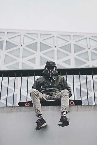 human man sitting longboard person