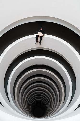 human man sitting on deep pit design person