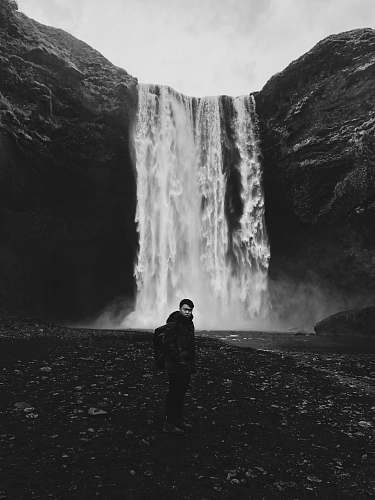 outdoors man standing in front of waterfalls nature