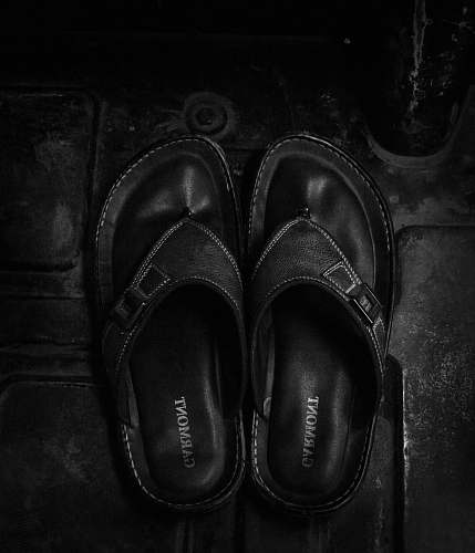 apparel pair of black leather sandals clothing