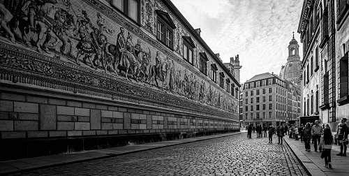 path people walking by concrete wall walkway