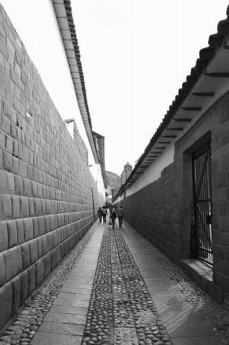 road people walks near concrete wall street