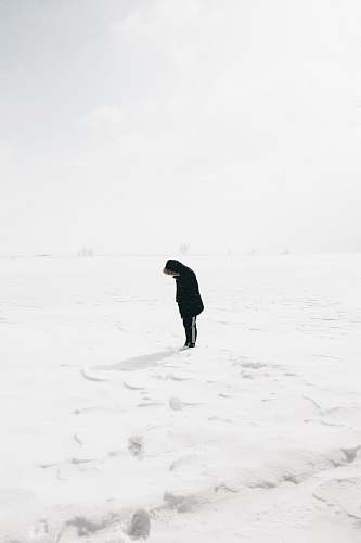 nature person standing on snow covered field person