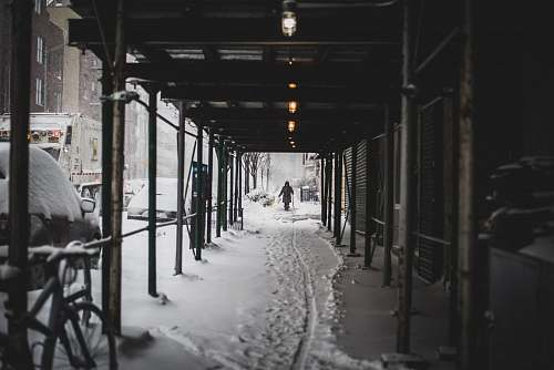 nature person walking on hallway covered in snow outdoors