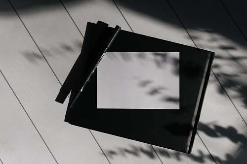 building photo of a paper and pen triangle